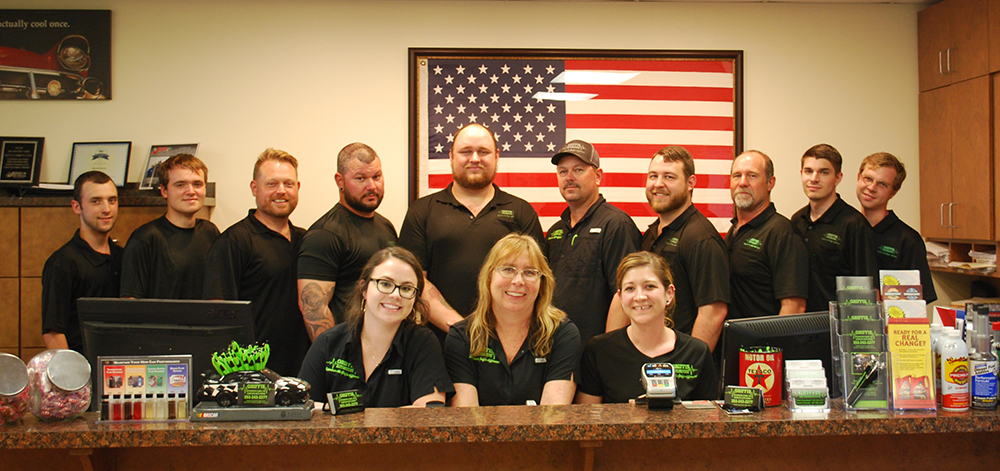The Griffis Automotive Clinic team posing for a photo