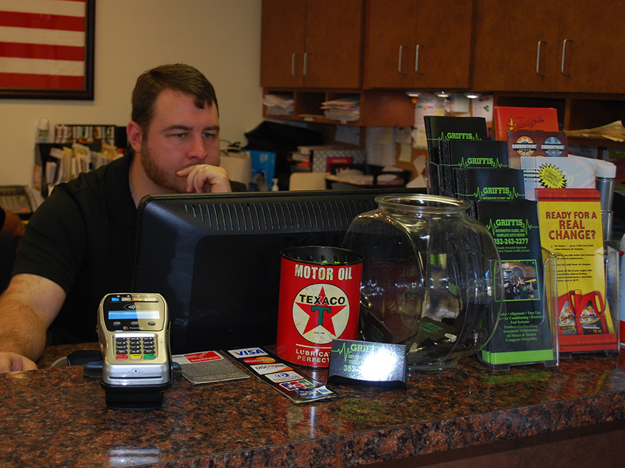 Photo of Brian Griffis working at the front desk